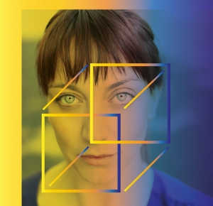 A woman directly looking at the camera, with a square cube outline over her face.