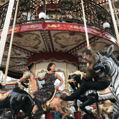 Two people riding a fair ground ride.