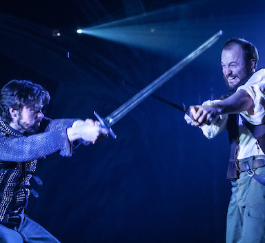 Two men fighting with swords.