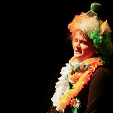 A woman dressed in Irish fancy dress, not looking directly at the camera.