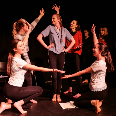 A group of young people performing on stage.