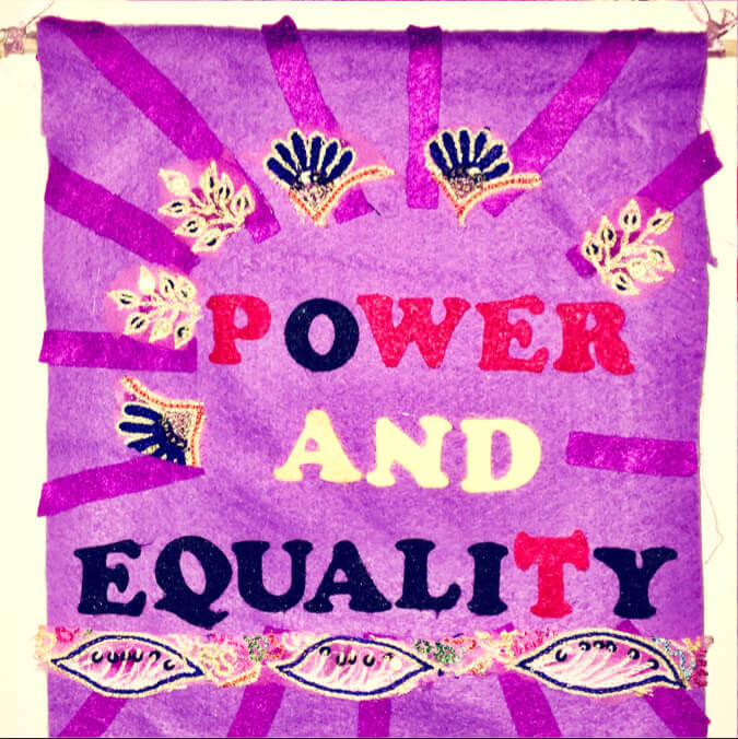 A purple banner which says 'Power and Equality'