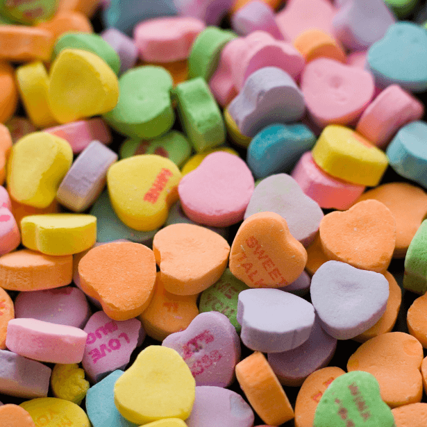 A close up of small heart shaped sweets.
