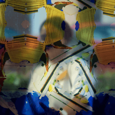Close up of a bus stop decorated with a repeated patterned vinyl. The outline of a young woman can be seen through the pattern.
